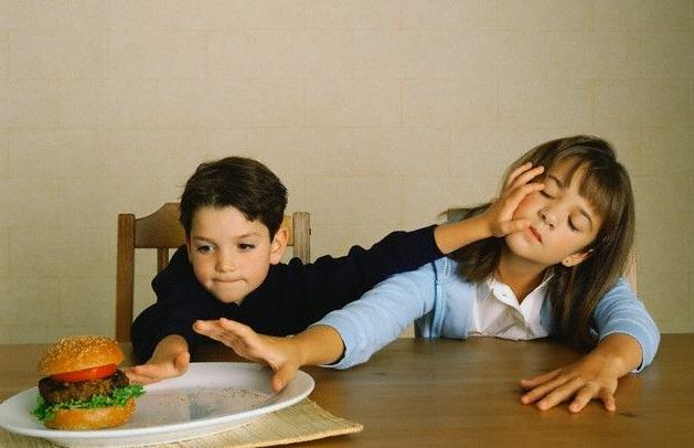 Siblings Fighting over Hamburger